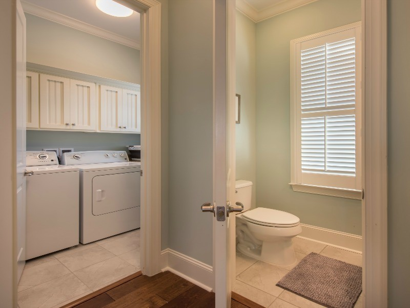 Powder Room and Laundry Room with Washer and Dryer