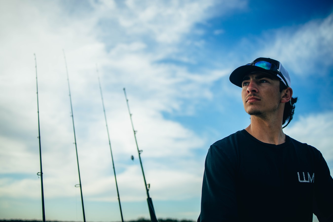 guy with fishing poles