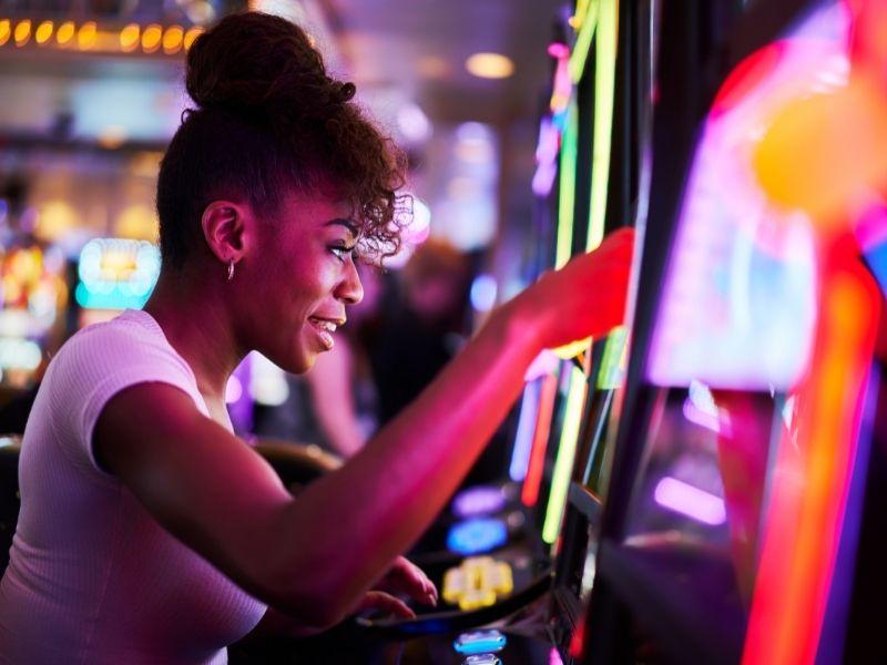 woman playing slot machine